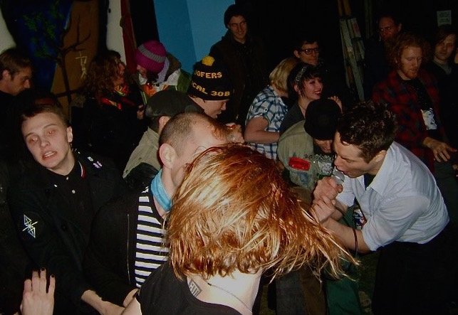 The crowd at one of the first shows Liz booked: Population playing Reversible Eye Gallery. Photo by Kellie Silvio