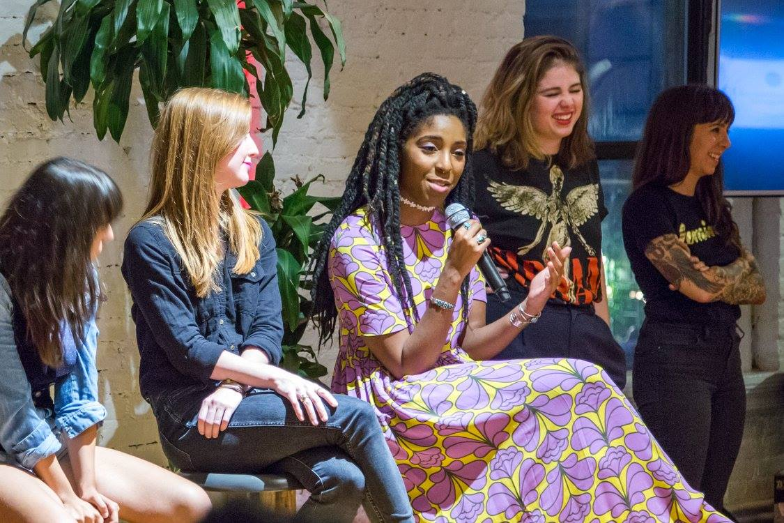 Panelist Jessica Williams makes Jane laugh at Babes Fest NYC. Photo by Julia Silva